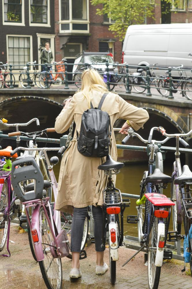 Woman with bicycle in Amsterdam - Gamesforlanguage.com