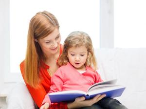 Language learning child with mother