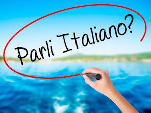 Parli Italiano written by woman's hand: Do you speak Italian?