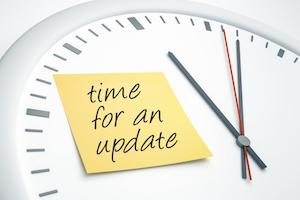 "Clock with sticky note: ""time for an update"""