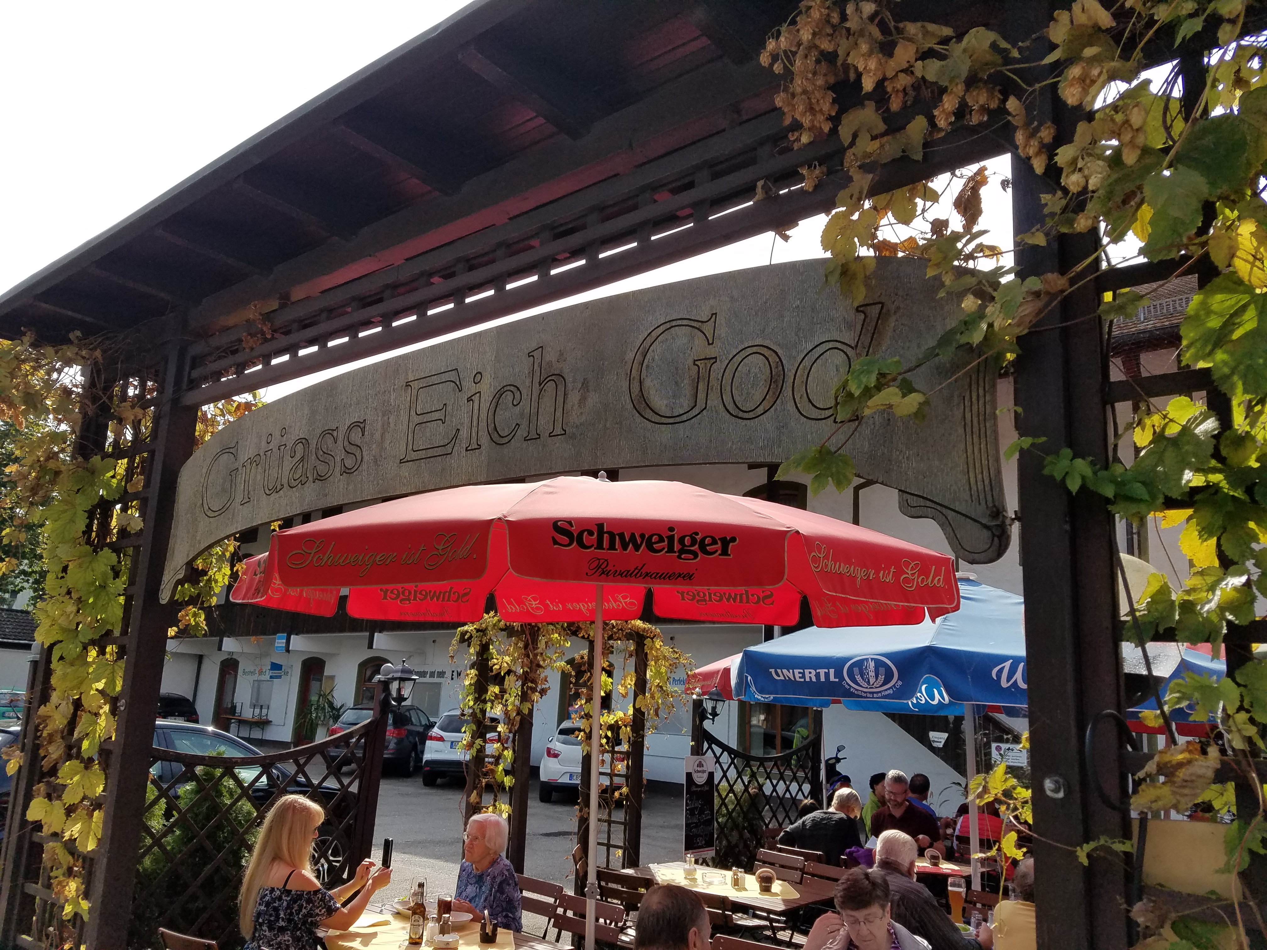"Beer Garden in Austria with ""Grüass Eich God"" sign - Gamesforlanguage.com"