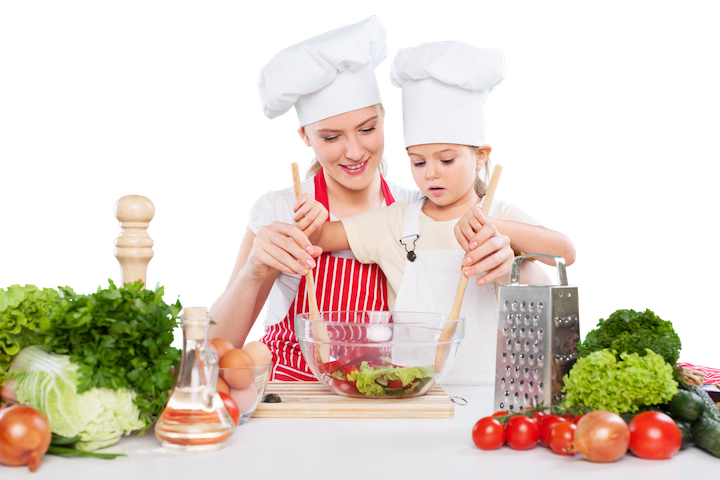 mother & daughter cooks in kitchen