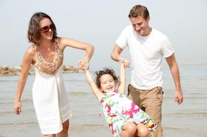 father, mother, and daughet at beach
