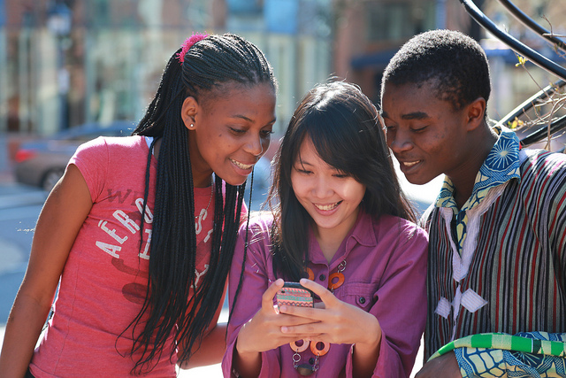 young people looking at phone