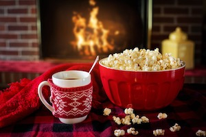 warm and cozy: popcorn in front of fireplace  Pixabay