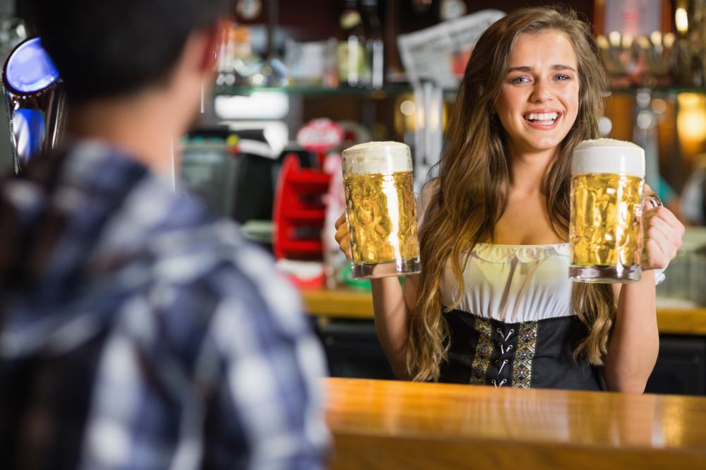 German barmaid serving beer - Gamesforlanguage.com