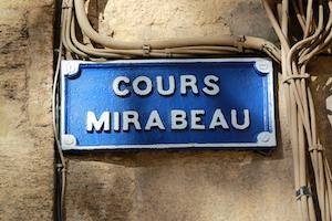Cours Mirabeau sign surrounded by wires