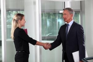 2 business people shaking hands