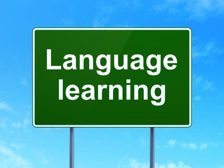 Language Learning on Road sign background