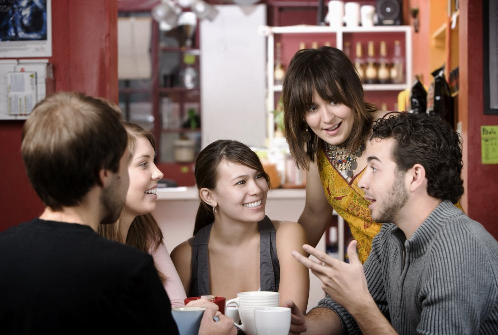 Friends discussing in coffee house