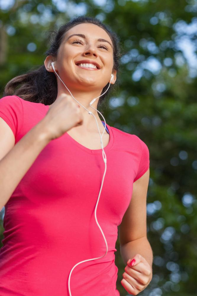 woman exercising with earphones - Gamesforlanguage.com