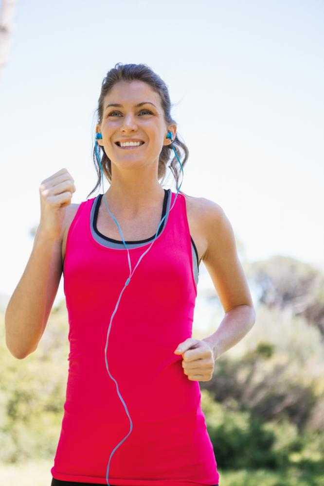 Woman jogging while listening to language podcast