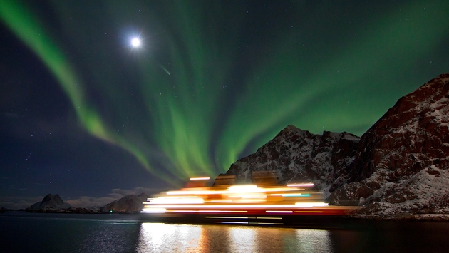Northern light above Hurtigruten ship