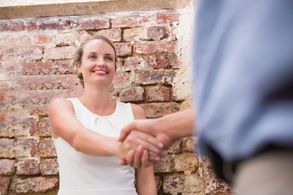 woman shaking hand - Gamesforlanguage.com